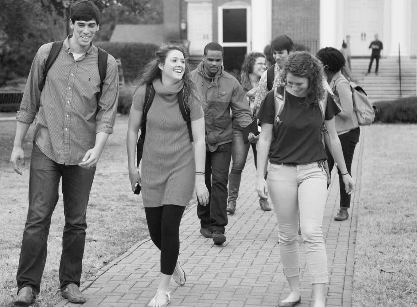 students walking to class laughing